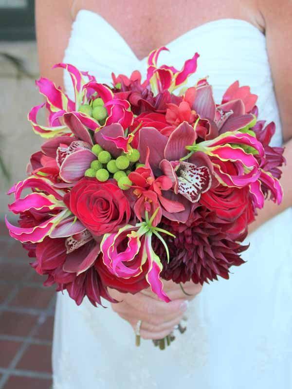 Ruby Reds Floral & Garden, Bridal bouquet of burgundy dahlias, burgundy cymbidium orchids, hot pink gloriosa lilies, green berzillia berries...