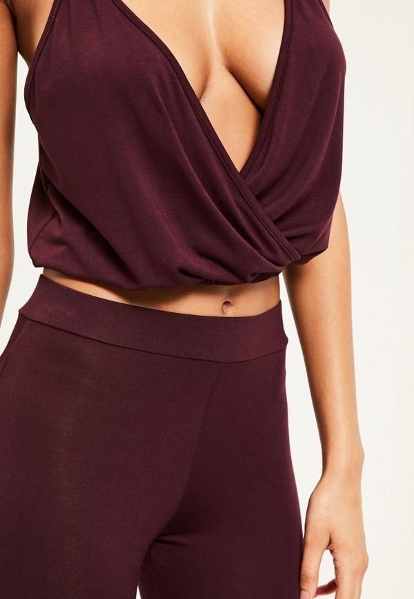 7bacc275ca53 Pose in style with this plum purple yoga top! With wrap front feature and  loose fit - this is perfect for helping find your zen!