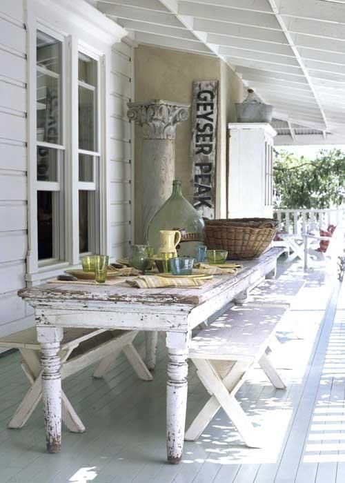 lovely porch. rustic table and benches