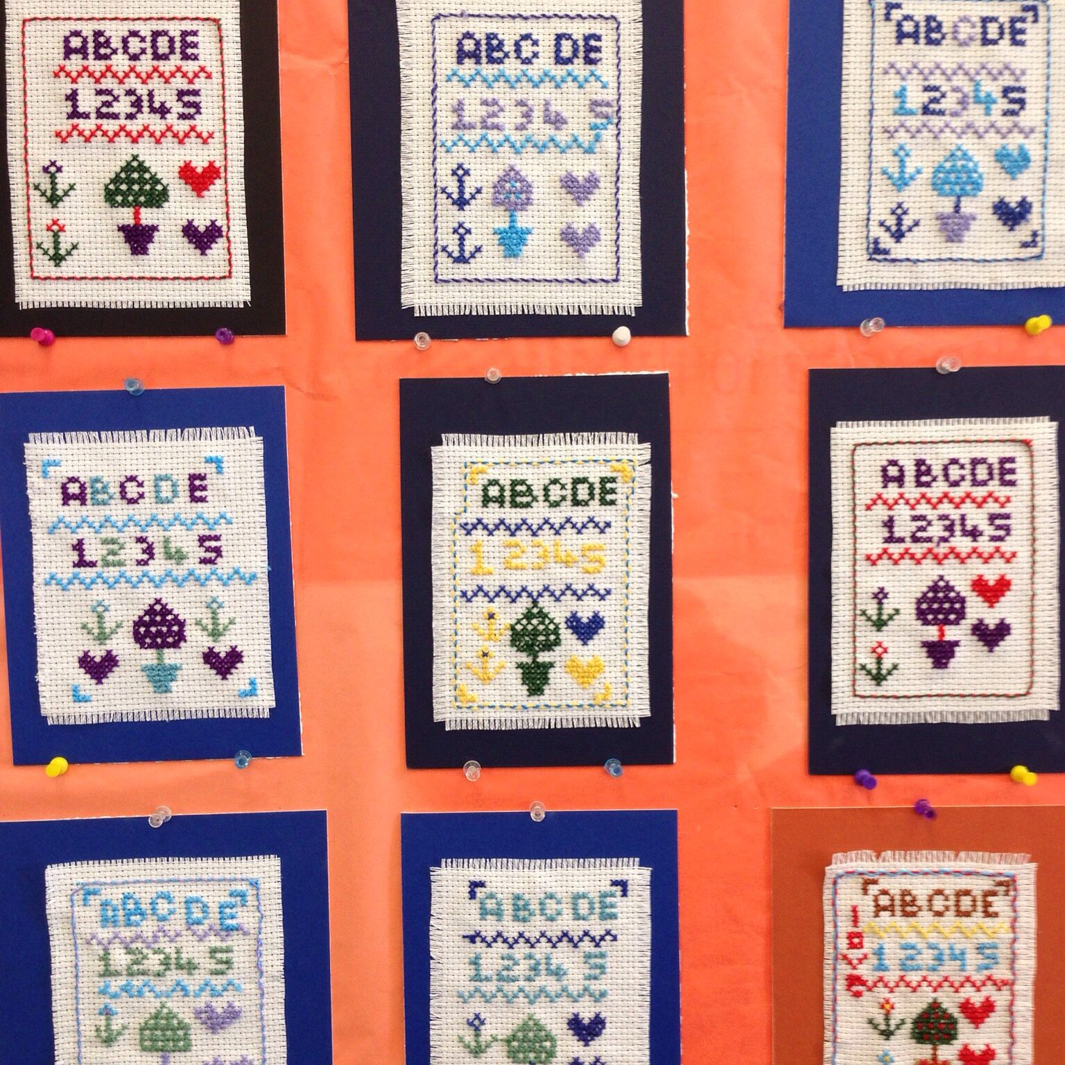 Just a very few of the 90 mini samplers embroidered by the third graders at El Granada Elementary School last year. They did a wonderful job and loved every minute of it.