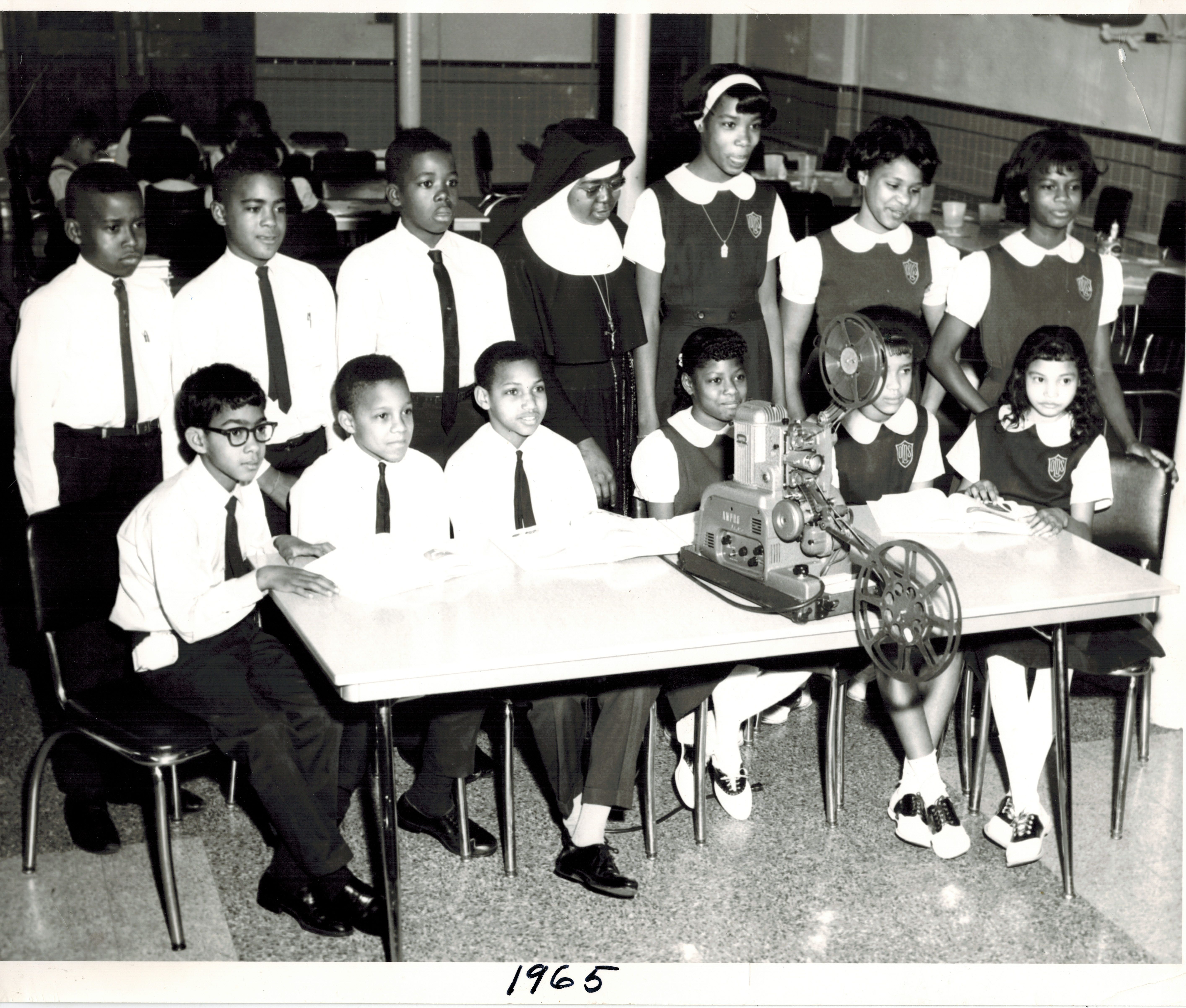 1965 Sister Angelica Wilson shows a film in the cafeteria