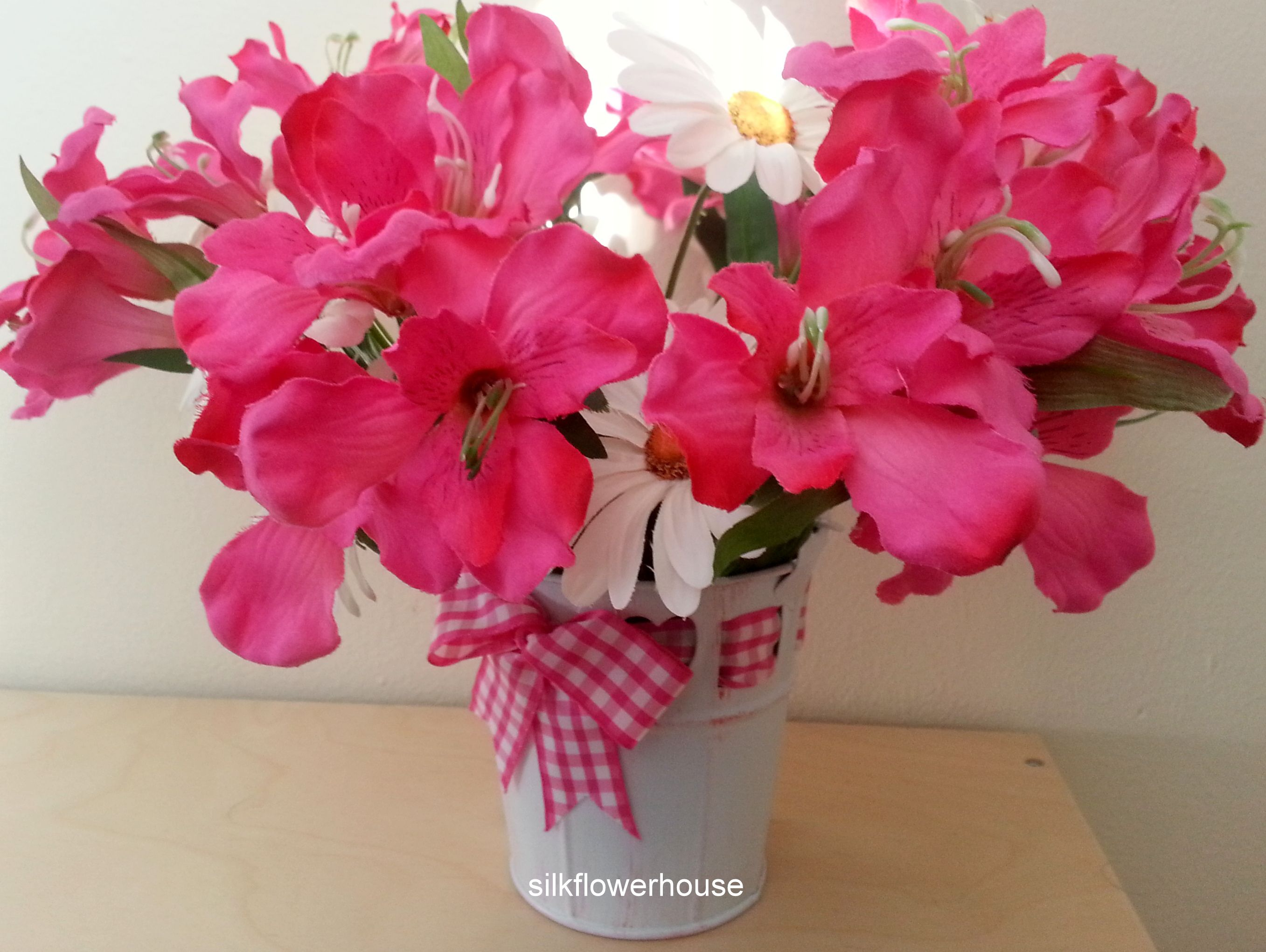 Selection Of Pink Silk Flowers In A Metal Pail For Grave Or Memorial