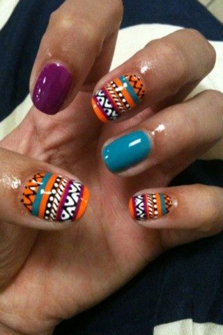 I love the colors! I would just pick one solid color for all my nails, but leave one the tribal print.