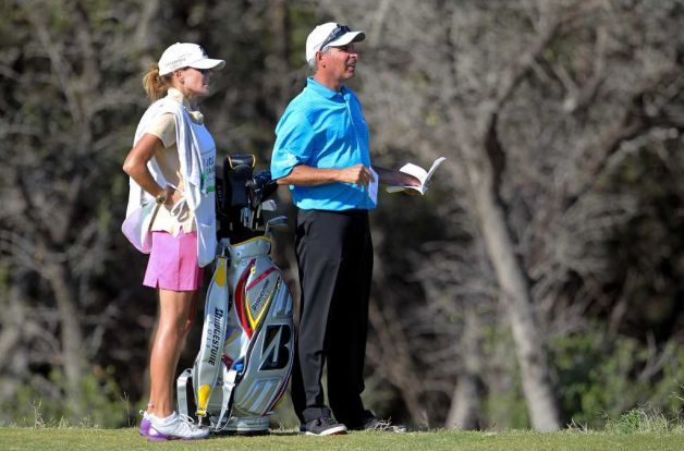 Fred Couples Studies The Fairway With His Caddie Midge Trammell