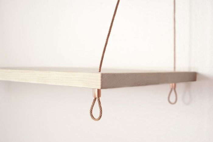 The Pantry Shelf is a modern suspension shelf made in San Francisco from natural pine and heavy-duty bronze cable.