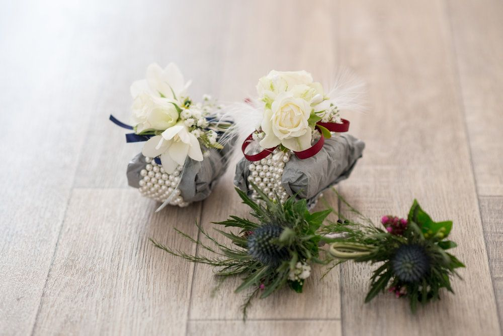 Wedding Guest Thistle Buttonholes With Wrist Corsages Wedding Flower Design Wedding Flowers Wedding Florist
