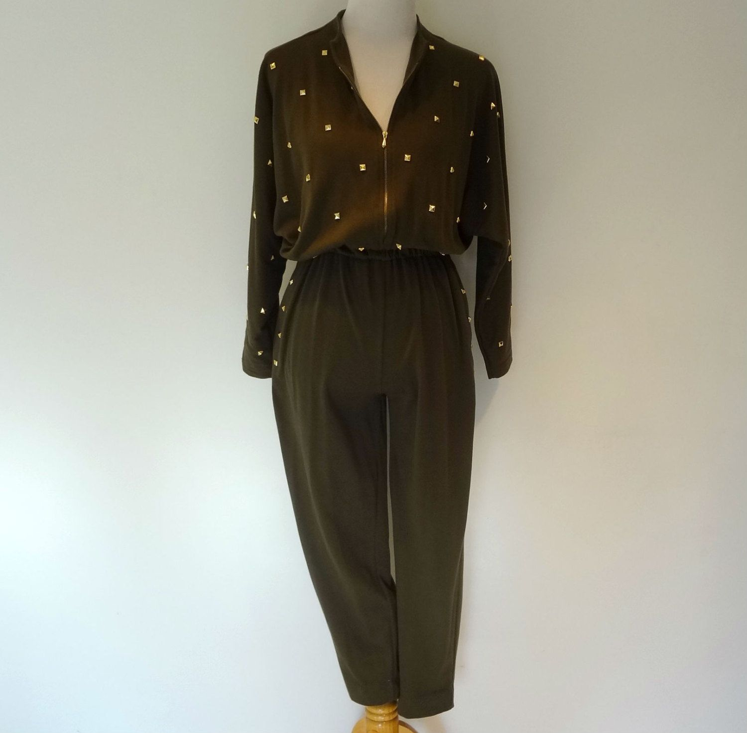 Vintage 1970s 1980s Olive Green Jumpsuit w/ Gold Studs Urban Retro Funky Disco S. $24.99, via Etsy.