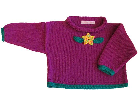 Violet Baby Sweater with Flower  Knitted and Crocheted by BurryBabies. I love using crochet as an edging and as appliques on my knitwear. This simple hand knitted baby sweater is made special by the crochet embellishment.