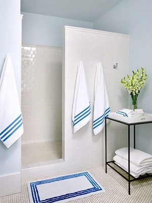 White Bathroom With Blue Accents By Decorology