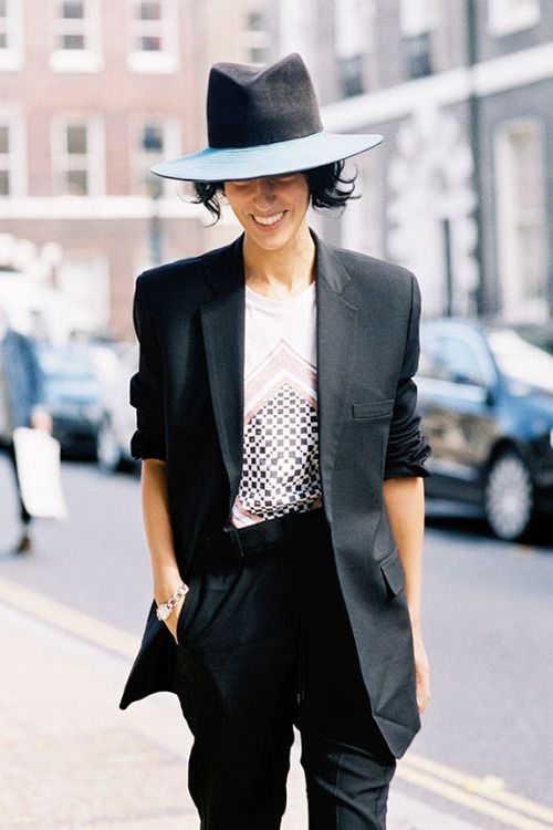 black tailored suit and fedora