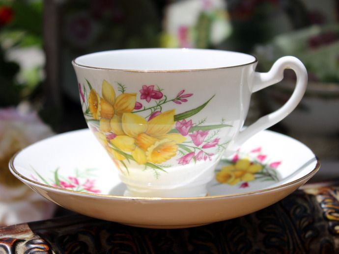 Clare Footed Teacup Tea Cup and Saucer - Daffodil. Made in England.   So cheerful!  No chips, cracks or crazing, all gilt is intact.Backstamp as pictured.