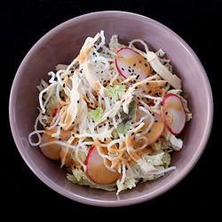Fresh napa, radishes, and crunchy glass noodles are topped with the dressing version of my mom's famous Thai peanut sauce. Delicious.