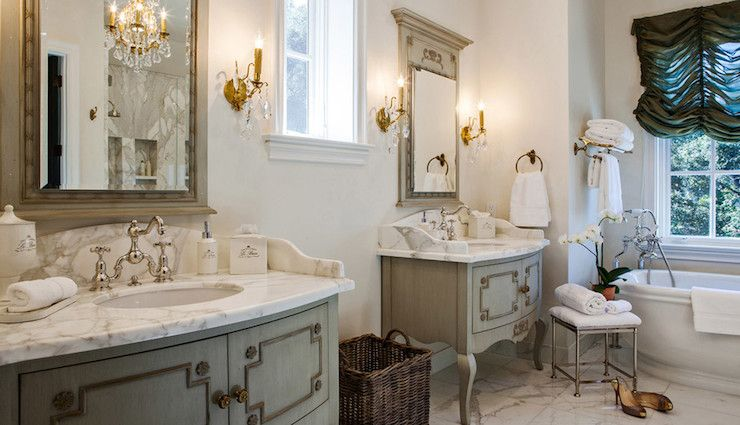 French Bathroom Features Gray French Mirrors Flanked By Antique - Antique brass bathroom sconces