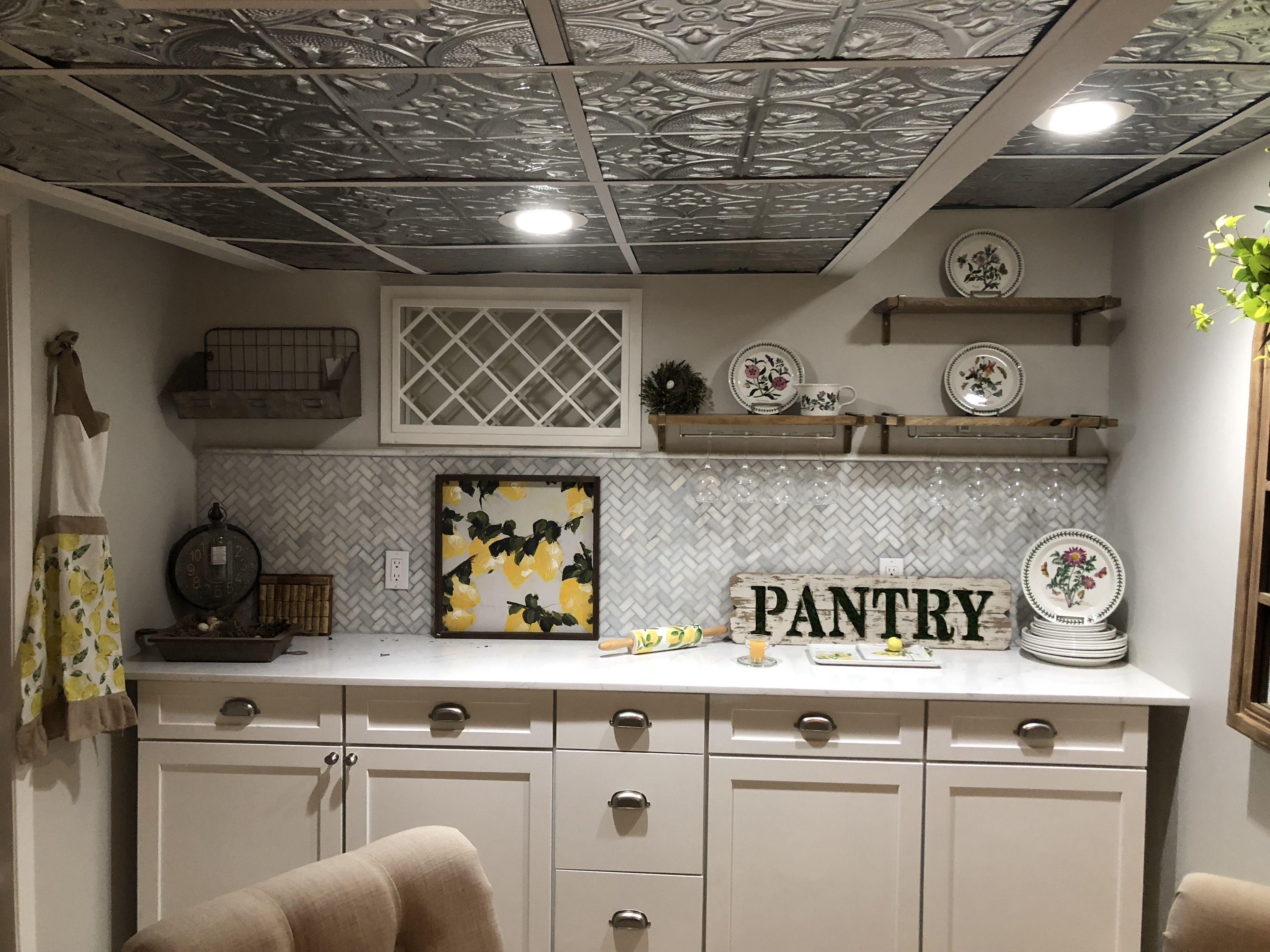 Basement, Tin Ceiling, Herringbone Marble Backsplash, Open Wood Shelves, Wine