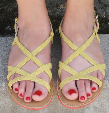 We love these adorable yellow sandals with their cute orange trim! The perfect summer shoes!