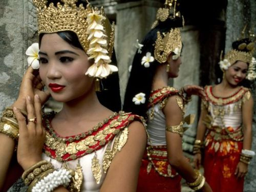 Dancers in traditional Khmer dress prepare to perform at the Angkor temple complex. Khmer culture almost vanished during the bloody reign of the Khmer Rouge communists in the 1970s, but Cambodians today are reclaiming their inheritance. (by Steve McCurry)