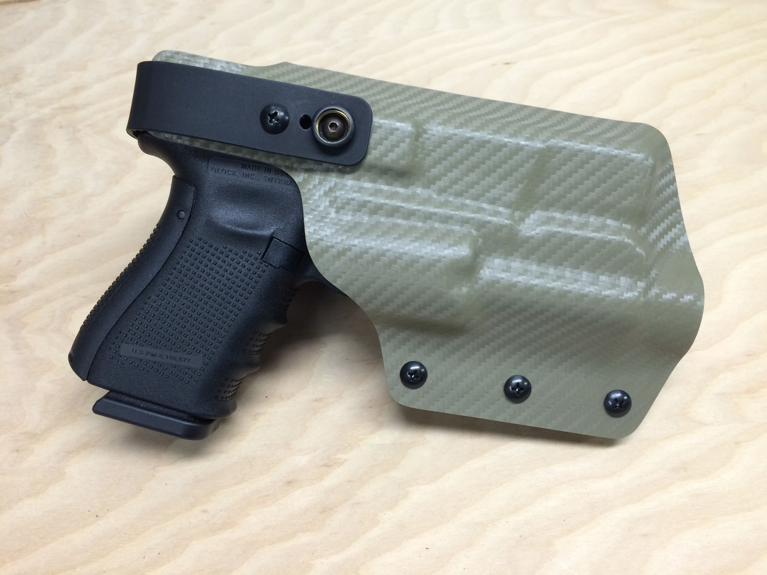 Glock 19 with TLR-2 light/laser  OWB retention holster with