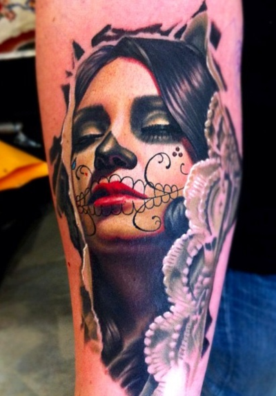 I would never have one, but Day of the Dead tattoos are some of the most beautiful tattoos out there.