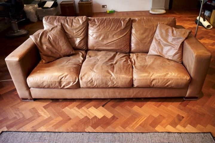 vintage worn in leather couch