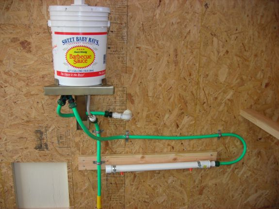 Hose and PVC setup for auto chicken waterer with toilet tank float