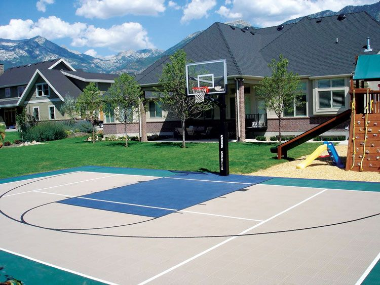 Great looking basketball courts home game courts by the for Home indoor basketball court cost