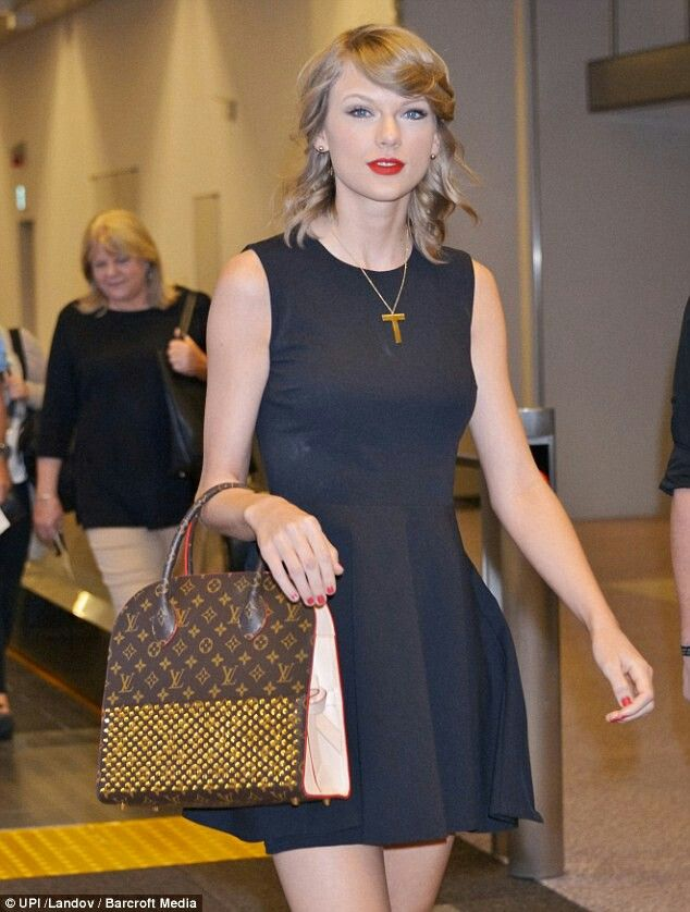 Designer Luggage She Added A Louis Vuitton Handbag To Her Classic Black Dress