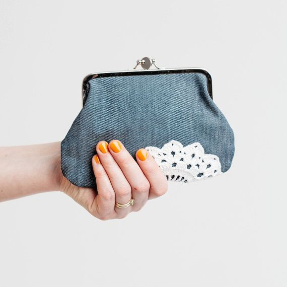 I made this small pouch using recycled fabrics and vintage lace.  Exterior is blue denim and interior is black floral cotton. White vintage doily is