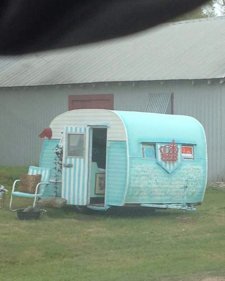 Cute little blue vintage camper with a striped door (For sale at the time this photo was taken)| Tiny trailer - travel caravan <O>