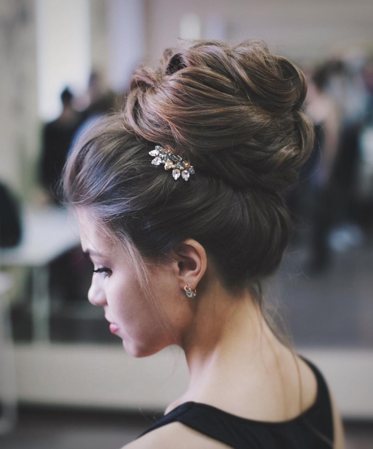 Elegant updo with small hair accessory weddinghairstyles bride