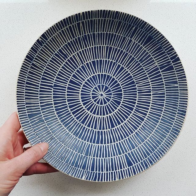 Finished sgraffito serving plate. I've got a few of these in progress in the studio at the moment. They've just had their blue slip applied and should be ready for carving tomorrow - my favourite bit!