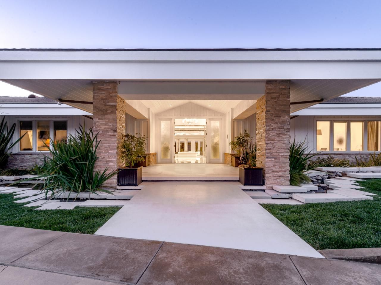 A ranch portico with clean, white lines prepares guests for the ...