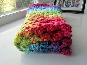 Rainbow granny square blanket using 4 strands