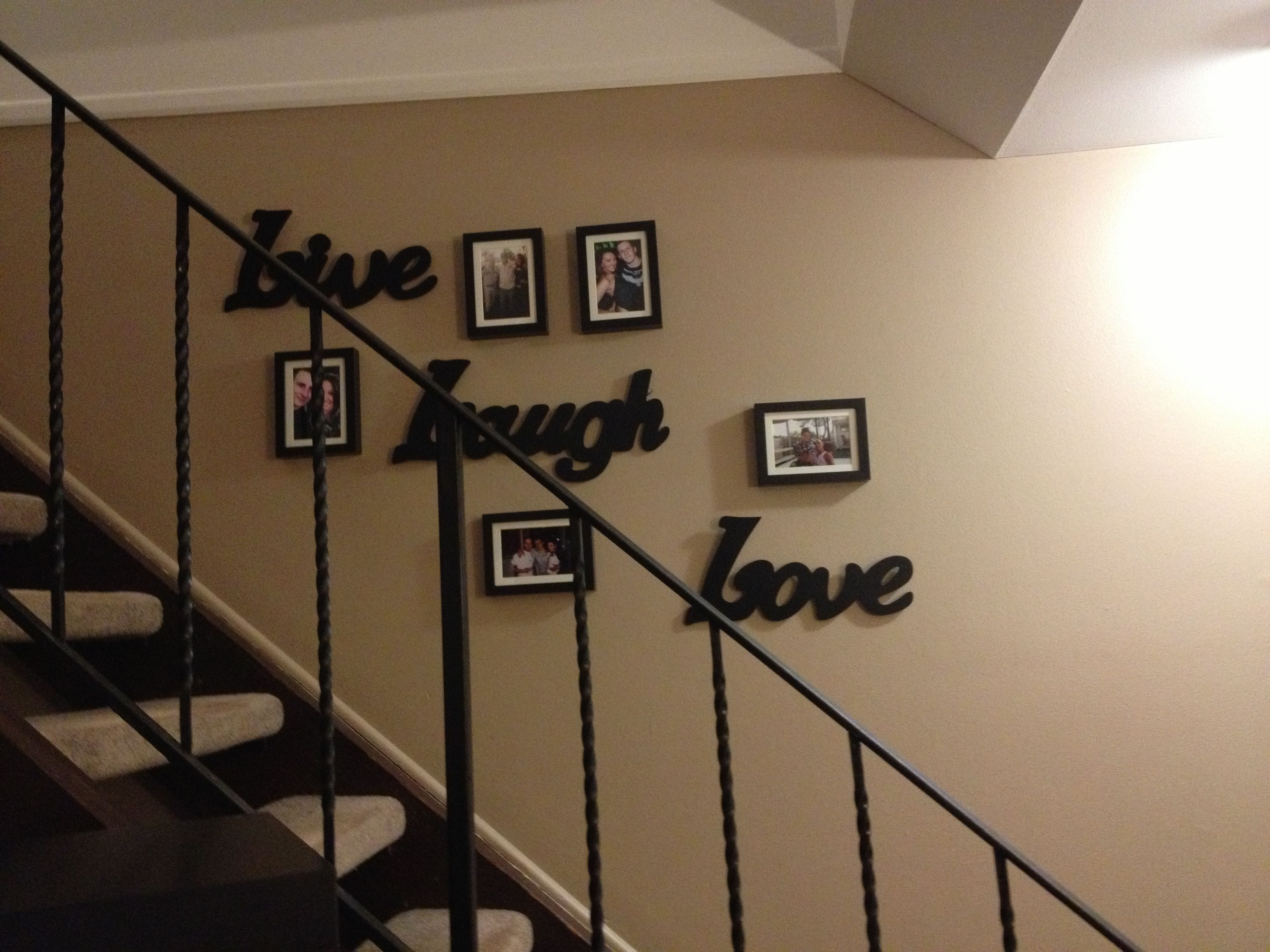 picture frame collage along stairs