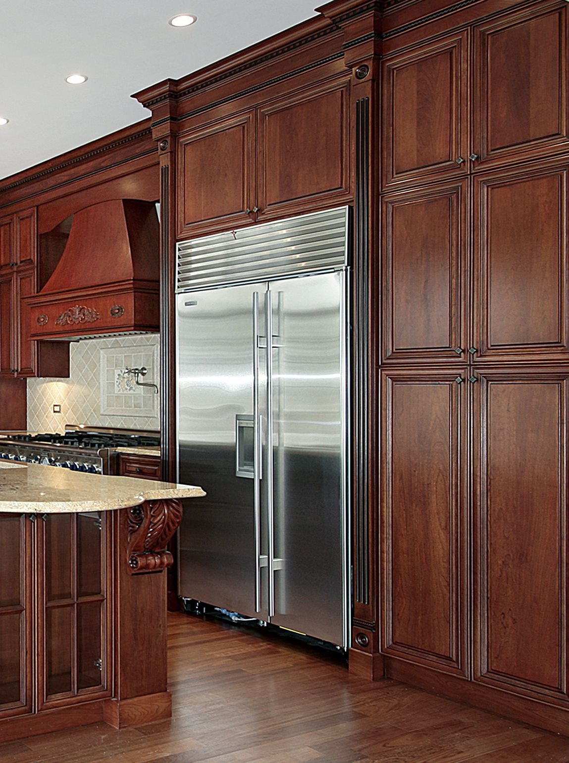 Cherry stained kitchen with sub zero fridge decorative for Great kitchens
