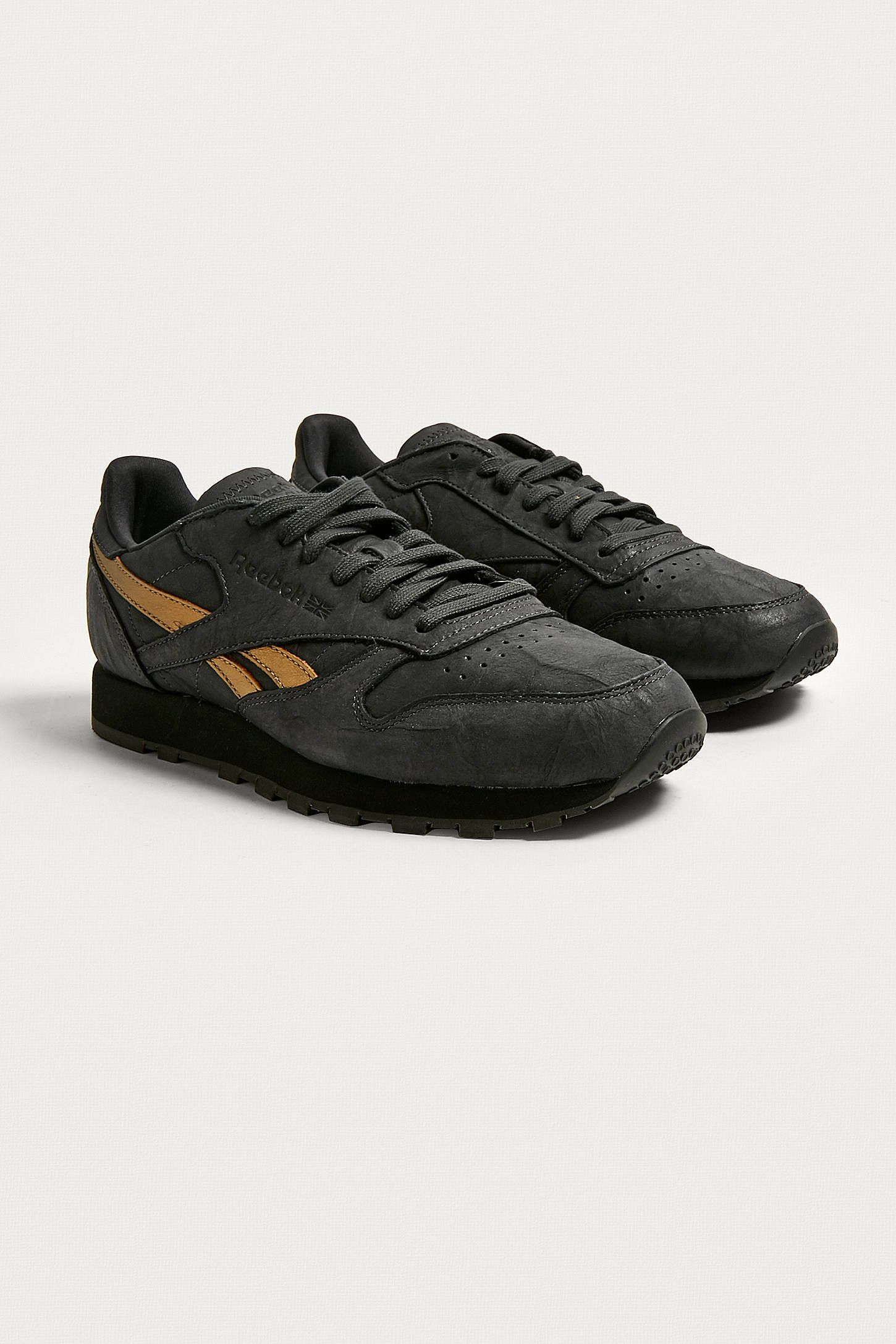 c88f4f87b32 Shop Reebok Classic Leather TU Black Trainers at Urban Outfitters today. We  carry all the latest styles