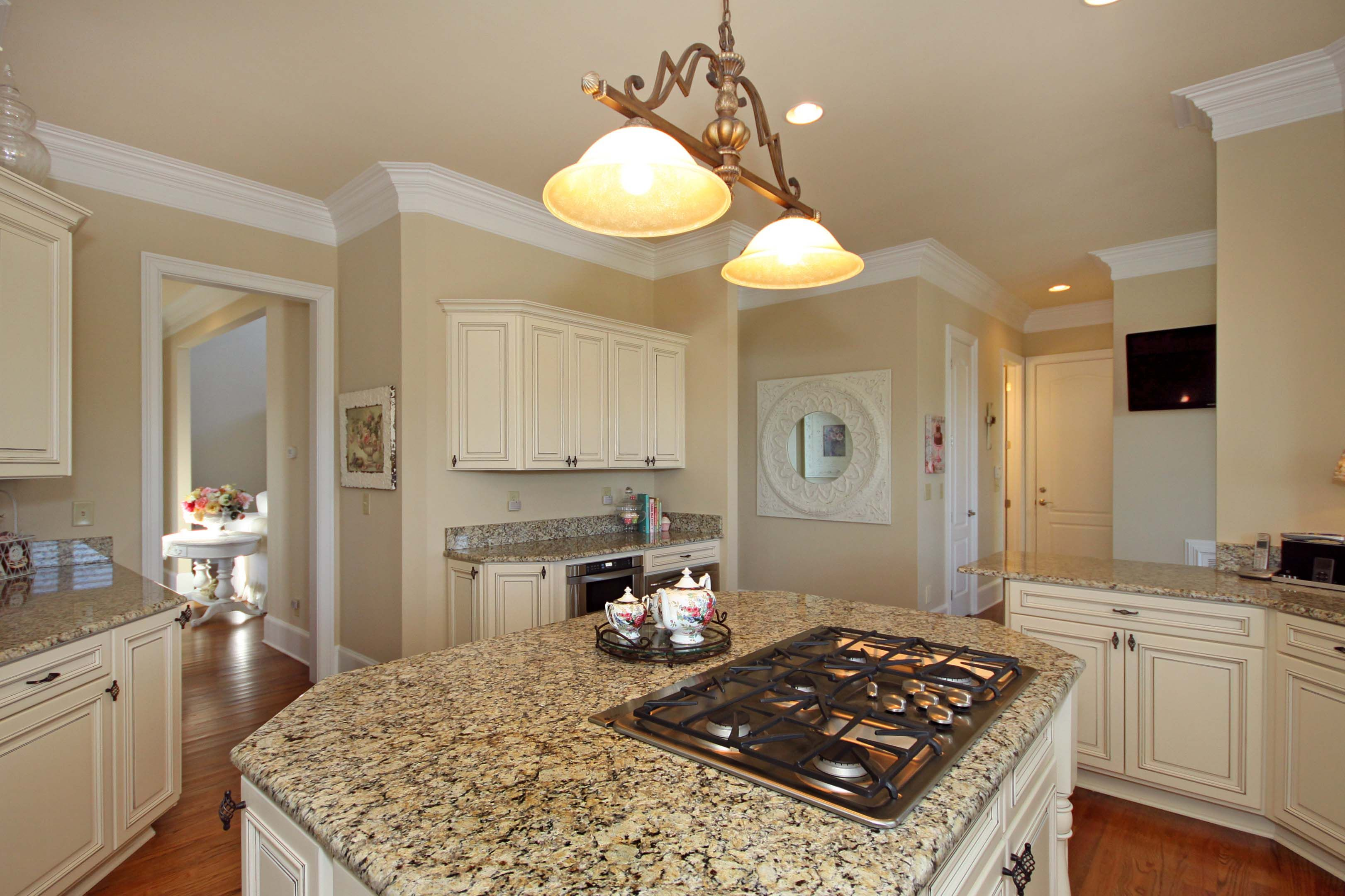 Gourmet Kitchen complete with oversized island | Gated Custom Home on brick front designs, gourmet cooking supplies, deck designs, patio designs, gourmet food, living room designs, laundry room designs, pantry designs, bathroom designs, large master bath designs, bedroom designs, family room designs, great room designs, high ceilings designs, dining designs, shared bath designs, roman tub designs, gourmet custom kitchens, marble floor designs, walk-in closets designs,