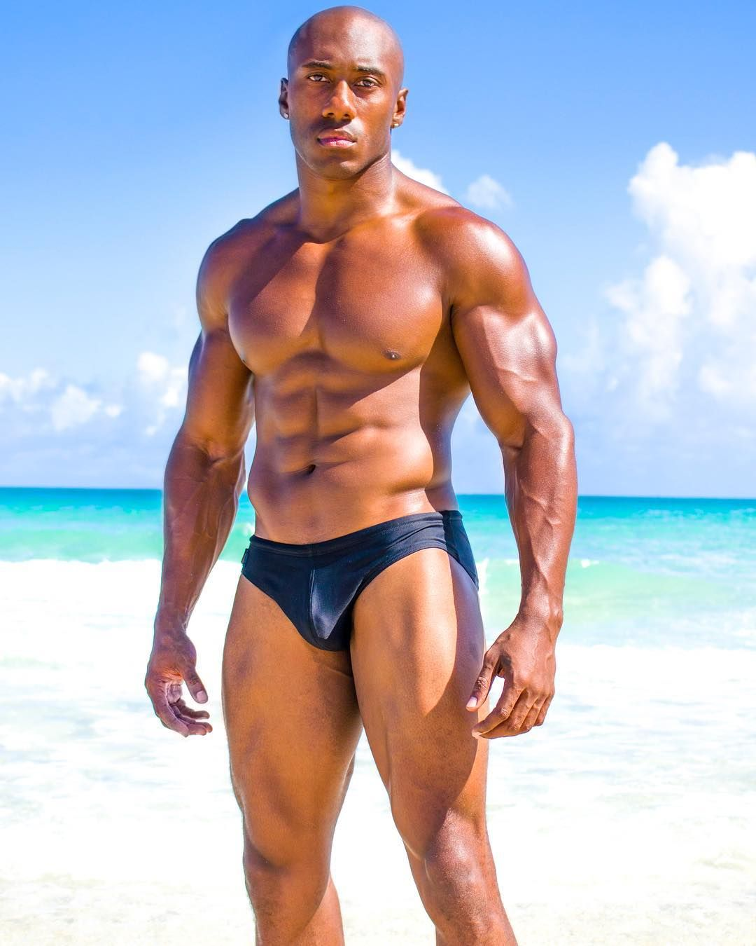 black-man-naked-on-beach-muscles