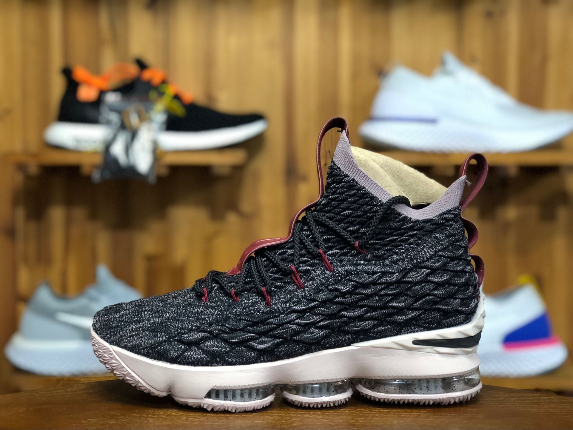 717cc26e17d098 Purchase this Nike Lebron 15 EP Black Taupe Grey-Team Red shoes in men s  size.