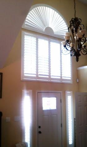 Large Shutter Above A Door And A Half Round Sunburst