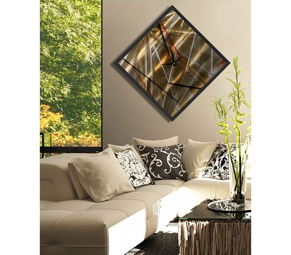 The clock strikes abstract gold metal wall clock by jon allen