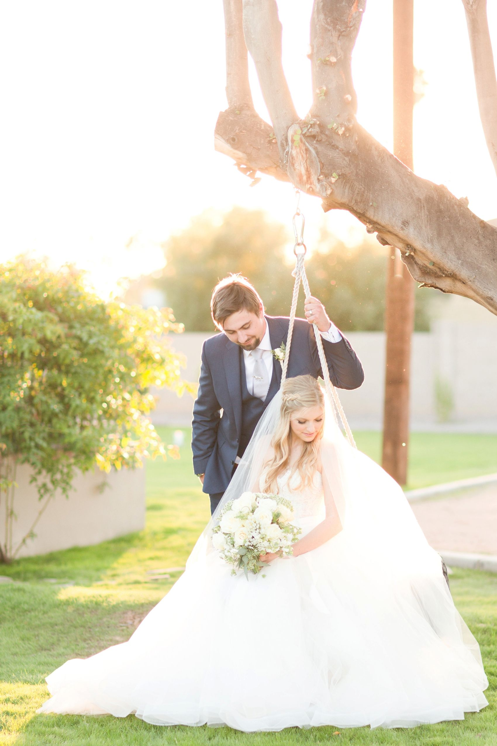 Historic private estate wedding in Phoenix, Arizona. Soft blues, periwinkle, and white. Fall autumn leaves. Groom in slate blue tux.