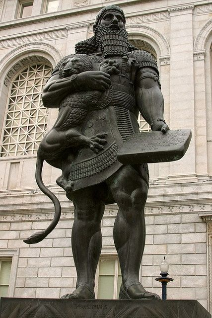 Gilgamesh and a lion.  Since that's a lion, how big was he to be able to hold it like a human man could hold a house cat?