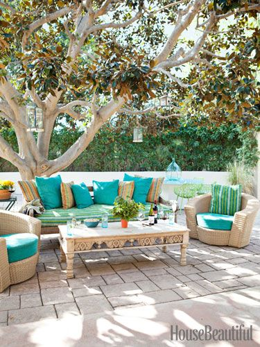 A vintage sofa and coffee table with Janus et Cie chairs. Design: Nickey Kehoe