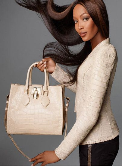 Supermodel Naomi Campbell shows of croc-print tote from Roberto Cavalli's Spring '12 line.