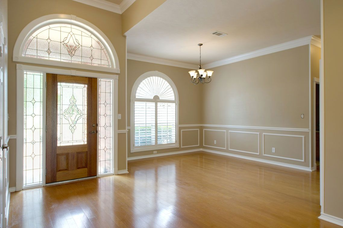 Overlooking the front yard, the large window ushers in ...