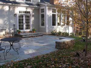 Bluestone patio and seat well in shaded backyard.