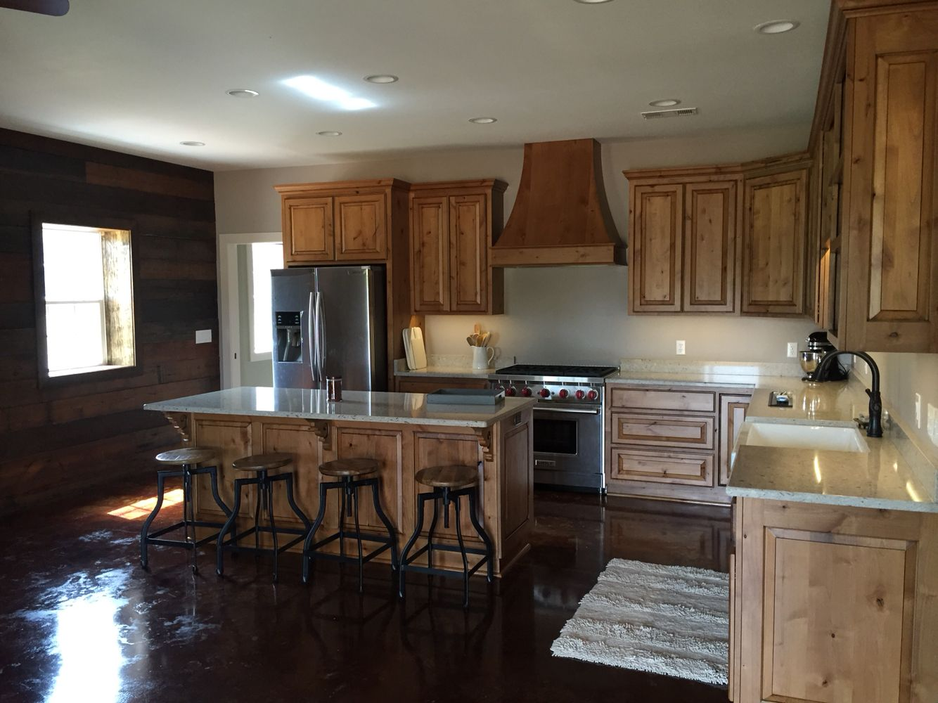 Rustic Knotty Alder Kitchen Cabinetry With Quartz Counter Tops From Cambria