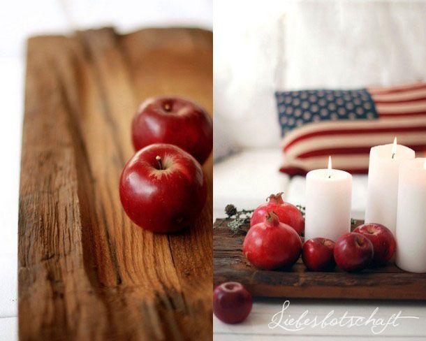 Herbstdekoration mit Äpfeln und Holz