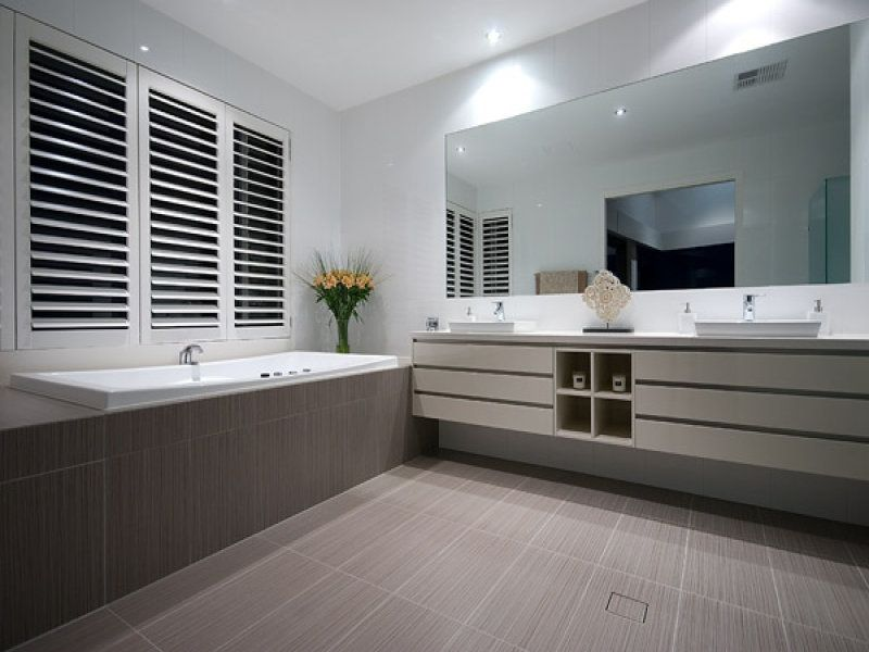 Images Of Photo of a modern bathroom design with corner bath using ceramic from the bathroom galleries Bathroom photo Browse hundreds of images of modern bathrooms