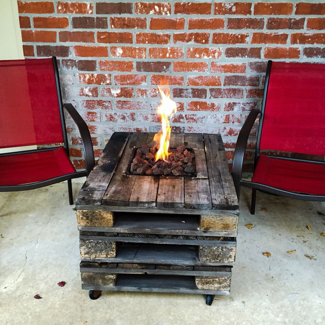 Gas fire pit built into a pallet table fire pit ideas for Pallet fire pit
